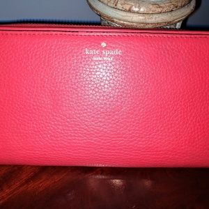 Red/pink Kate Spade zip around wallet.